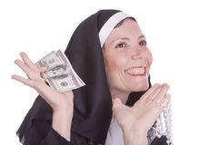 Nun holding money Stock Photo