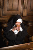 Nun kissing prayer book Royalty Free Stock Images