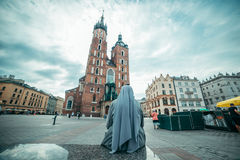 Nun looking on old church Royalty Free Stock Image