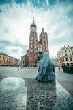 Nun looking on old church Stock Image