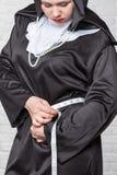 Nun measures waist volume Stock Images