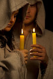 Nun and monk praing with candles Royalty Free Stock Photo