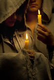 Nun and monk praing with candles Royalty Free Stock Image
