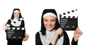The nun with movie board isolated on white Stock Images