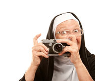 Nun with old camera stock photography