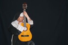 Nun playing the guitar Royalty Free Stock Photography