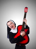 Nun playing guitar Stock Images