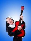 Nun playing guitar against the gradient Royalty Free Stock Images