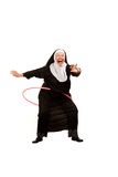 Nun playing with plastic hoop Stock Images