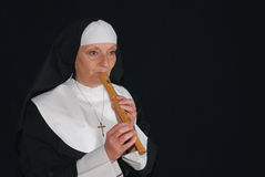 Nun playing the recorder Royalty Free Stock Photo