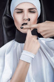 Nun with crossed fingers Stock Photo