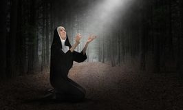 Nun, Pray, Prayer, Christian, Religion, Christianity, Religious. Illustration of a nun praying to god and Jesus in heaven. The woman is a devout Christian royalty free stock photos