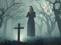 Nun in prayer before cross. At night Stock Image