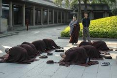 Nun in prayer. Fine art portrait of a novice nun in deep prayer with rosary royalty free stock photo