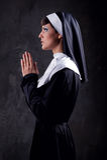 Nun praying. Young attractive nun praying indoors royalty free stock image