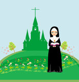 Nun praying in front of the church Royalty Free Stock Image