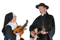 Nun and priest. Middle aged nun and priest playing the guitar.Intense expressions on face Royalty Free Stock Photography