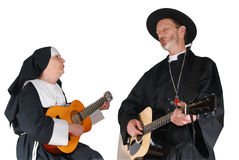 Nun and priest guitar. Middle aged nun and priest playing the guitar.  Religion, christianity, lifestyle, entertainment, music, concept Stock Photography