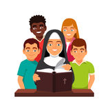 Nun is reading Holy Bible to mixed race teens Stock Photo