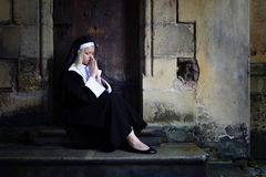Nun on the stairs Royalty Free Stock Photos