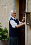 Nun. In the street trying to open the door. Photo taken on Sep,2013 stock image