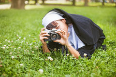 Nun taking a picture Royalty Free Stock Images