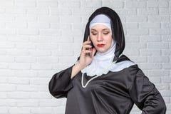 Nun talking on the phone Stock Image