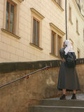 Nun tourist. Nun looking up at the historical building stock images