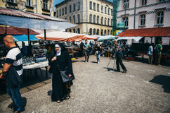 Nun walk through the market in Kazimierz. Stock Photo