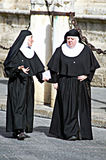 Nun walking in the street 1. This is the urban life of Seville: Some nuns are walking in the street Royalty Free Stock Photo