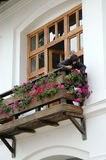 Nun waters the flowers. TISMANA, ROMANIA - AUGUST 21, 2008: A nun dressed in black waters the flowers on the balcony of the Orthodox Monastery of Tismana Stock Photos