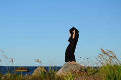 Nun woman on the beach Stock Photography