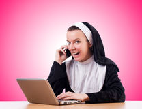 Nun working on laptop - religious concept Royalty Free Stock Photography