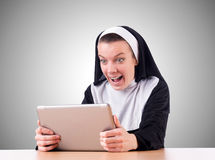 Nun working on laptop - religious concept Stock Images