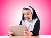 Nun working on laptop - religious concept Royalty Free Stock Photos