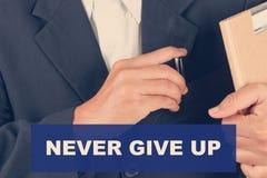 Nunca abandone las citas - fondo del hombre de negocios Foto de archivo