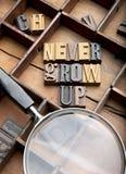 Nunca cresça acima foto de stock