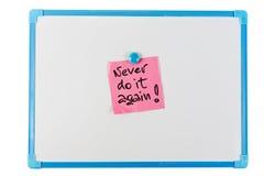 Nunca hágalo otra vez - el recordatorio de papel Foto de archivo