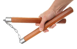 Nunchaku in a hand Royalty Free Stock Photos