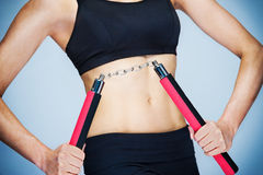 Nunchaku Workout Girl Royalty Free Stock Images