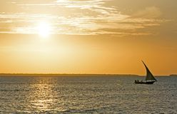 Cruising on a dhow at sunset, Nungwi, Zanzibar, Tanzania. Nungwi is a village at the northern end of the Tanzanian island of Unguja, familiarly called Zanzibar Stock Photo