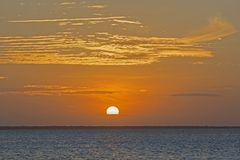 Magnificient sunset viewed from the beach, Nungwi, Zanzibar, Tanzania. Nungwi is a village at the northern end of the Tanzanian island of Unguja, familiarly Royalty Free Stock Photos