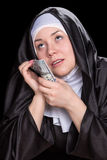 Nunna med pengar Royaltyfria Bilder