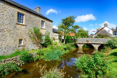 Nunney in Somerset. Pretty cottages and a bridge over the river at Nunney in Somerset royalty free stock image