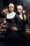 Nuns. Attractive young nuns posing in the church royalty free stock photo