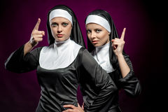 Nuns. Attractive young nuns posing indoors stock photography
