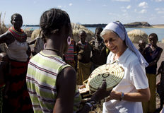 Nuns of Christian church buy handicrafts african tribe Royalty Free Stock Photos