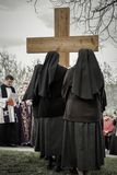 Nuns with cross at calvary. RUZOMBEROK, SLOVAKIA - APRIL 14: Nuns with cross at calvary. The Way of the cross during easter on April 14, 2019 in Ruzomberok royalty free stock image