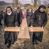 Nuns with cross at calvary stock photos
