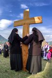 Nuns with cross at calvary. RUZOMBEROK, SLOVAKIA - APRIL 14: Nuns with cross at calvary. The Way of the cross during easter on April 14, 2019 in Ruzomberok stock photography
